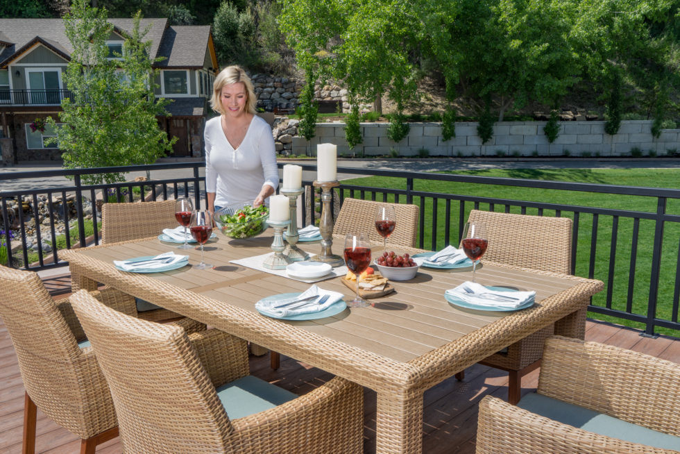 Woman setting outdoor dining table